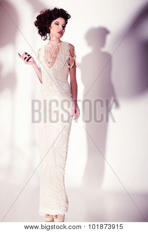 Beautiful Woman Model Posing In Elegant Pearl Dress In The Studio