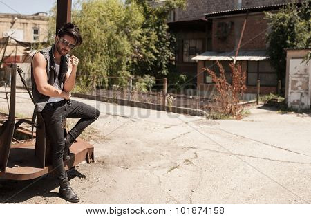 Handsome Man Model Dressed Punk, Hipster Posing Dramatic In Grun