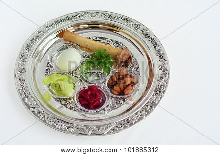 Passover Seder Plate with The seventh symbolic item used during the seder meal on passover Jewish holiday. White background with copy space