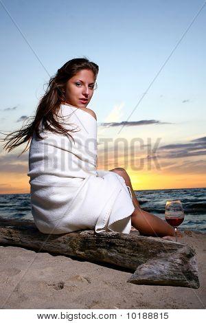 Woman Drinking Wine On Beach