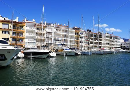 CASTELLO DE EMPURIES, SPAIN - MAY 21: Yachts moored in the marina of Empuriabrava on May 21, 2015 in Castello de Empuries, Costa Brava, Spain. Empuriabrava is the largest residential marina in Europe