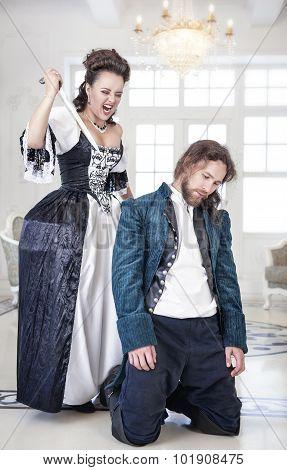 Beautiful Woman In Medieval Dress Killing Man By Dagger