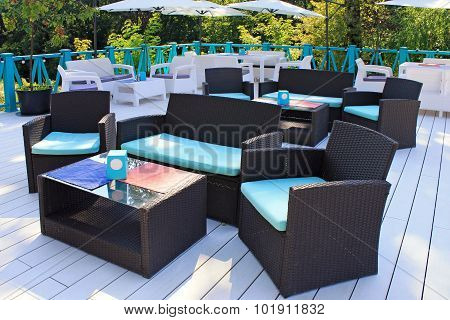 Al Fresco Cafe With Rattan Furniture On The Garden Terrace