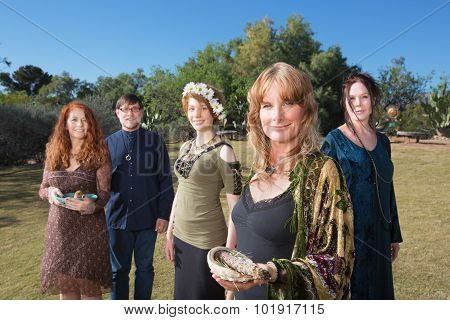 Polytheists Outdoors With Smudge Sticks