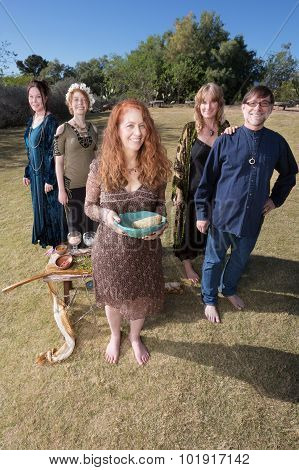 Five Witches With Smudge Stick Outdoors