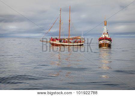 Husavik, Iceland - September 10, 2013: Whale watching ships in the Skjalfandi Bay in Northern Iceland