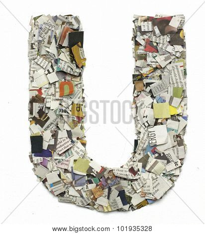 The letter  U  made from newspaper confetti poster