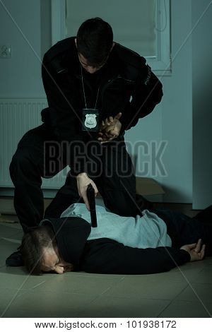 Police Officer Overpowering A Criminal