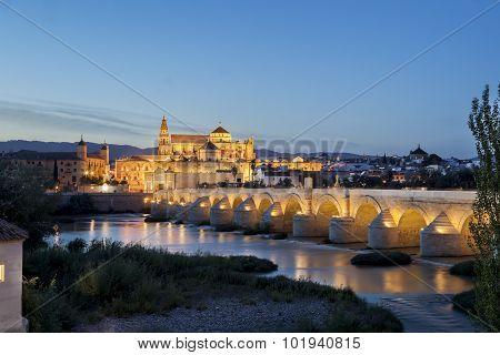Bridge And Mosque Of Cordoba Over Guadalquivir River