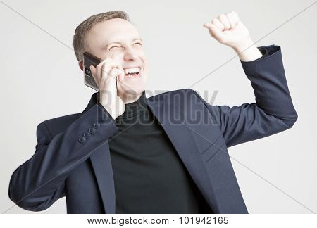 Handsome Caucasian Man In Elegant Siut Speaking Using Cell Phone With Positive Expression