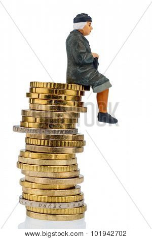 pensioner sitting on a pile of money, symbol photo for pensions, retirement, pension