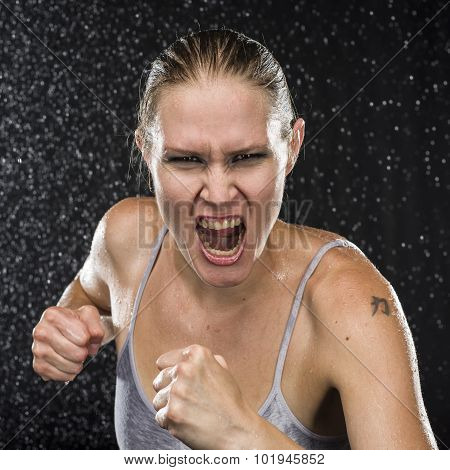Irate Female Fighter Screaming at the Camera