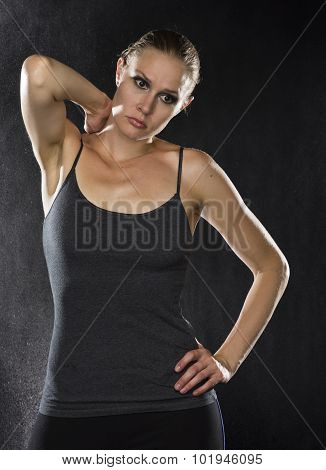 Thoughtful Sporty Woman with Hand on her Neck