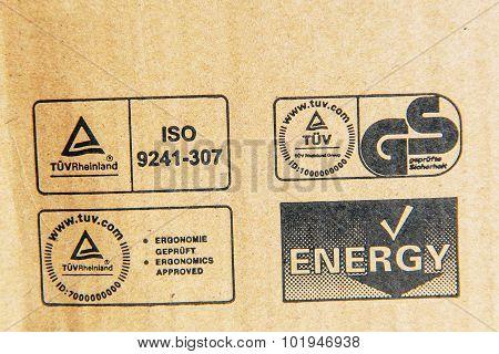 Tuv Rheinland, German Stadard, Energy, Iso Signs On A Computer Cardboard Box
