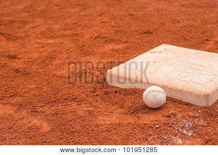 Baseball And Base On Baseball Field