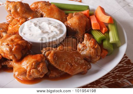 Buffalo Wings With Cheese Sauce And Vegetables Close-up. Horizontal