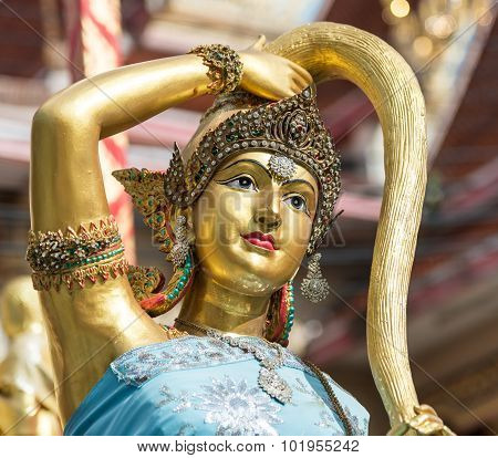 Earth Goddess Bronze Statue  Closeup On Face In Thai Style Temple