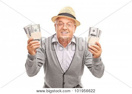 Overjoyed senior gentleman holding two stacks of money and smiling isolated on white background poster