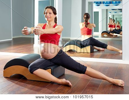 pregnant woman pilates side stretchs exercise with Wave corrector