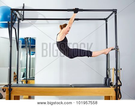 Pilates woman in cadillac acrobatic reformer exercise at gym