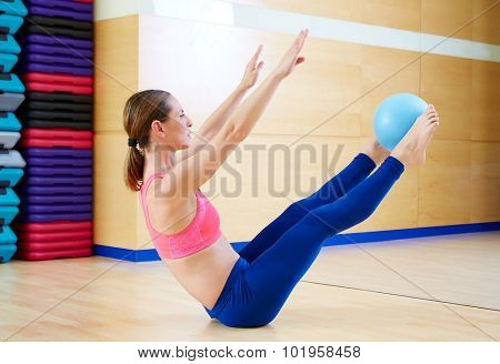 Pilates woman stability ball teaser exercise workout at gym indoor poster