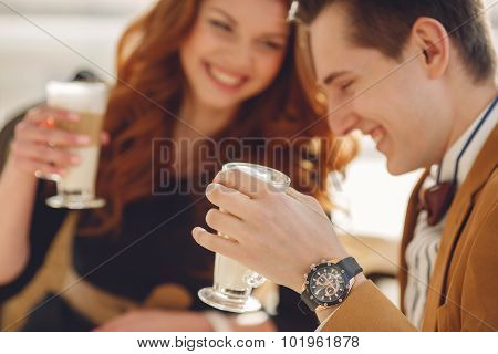 A loving couple enjoying an aromatic coffee in the café