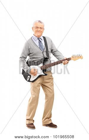 Full length portrait of a confident senior gentleman playing on an electric guitar and looking at the camera isolated on white background