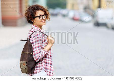 Nice girl standing in the street