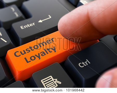 Pressing Orange Button Customer Loyalty on Black Keyboard.