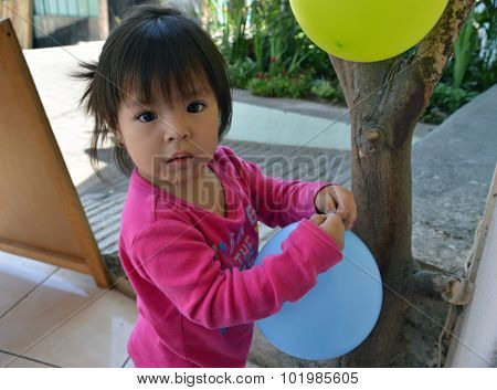 Child Plays With Balloons (2)
