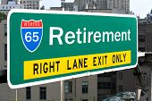 A conceptual highway sign to illustrate the average retirement age of 65 years old. poster