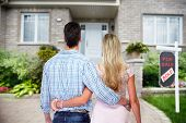 Young loving couple looking at new home. Mortgage. poster
