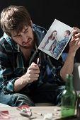 Young desperate heartbroken guy destroying love photos poster