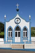 Traditional Azores catholic chapel in Santo Antao. Sao Jorge. Portugal. Vertical poster