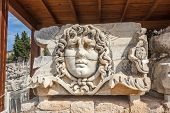 Part architrave with frieze with mythical giant Gorgon Medusa head in ancient Temple of Apollo in Didim Turkey poster