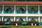 facade of summer resort villa with balconies in scenary garden poster