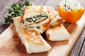 Borek or pita, filo pastry with cheese and spinach filling poster