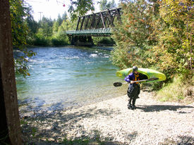 Kayaker By River