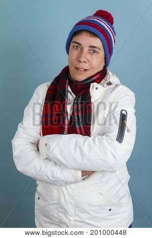 Woman with bobcap and scarf . Shot in Studio.