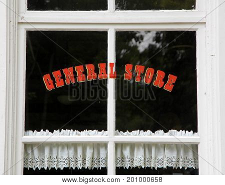 General store text on black window