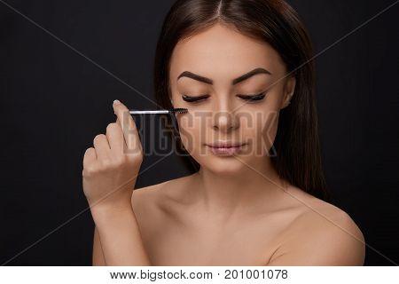 Mascara. Beauty Makeup Fresh Soft Skin And Long Black Thick Eyelashes Applying Mascara With Cosmetic Brush. Eyelashes extensions. Fake Eyelashes.