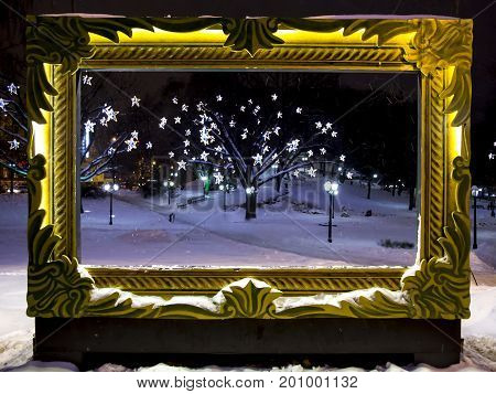 Central park in Riga night decorated for Christmas and New Year celebration. Latvia. In this frame you can make a photo for memory of Riga.