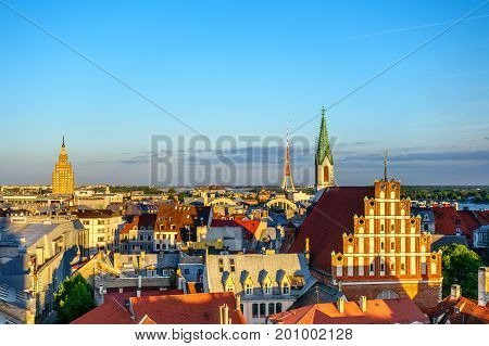 Panorama of Old Riga on sunset with St. Peters Church tower