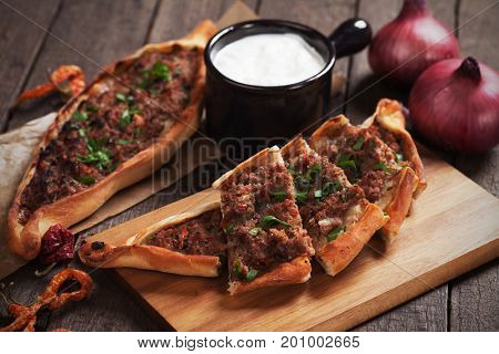 Turkish pide, meat and pastry street food similar to pizza