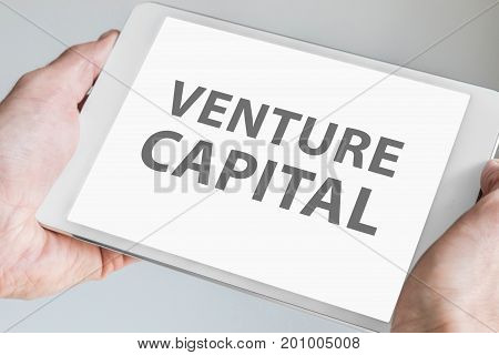 Venture capitalist text displayed on touchscreen of modern tablet or smart device.