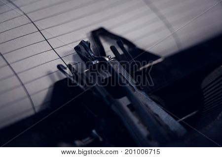Cropped image of typewriter with paper