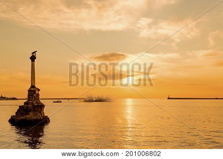 Sunset in Sevastopol Bay with the famous Monument to the Sunken ships on foreground, Crimea