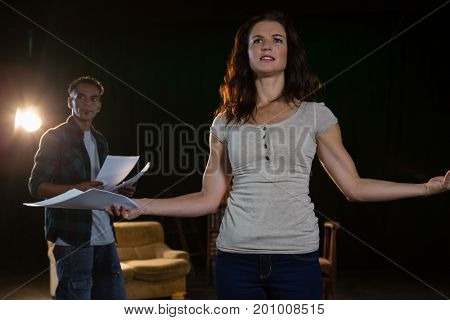 Artists rehearsing on stage in theatre
