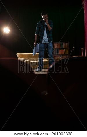 Artist rehearsing on stage in theatre
