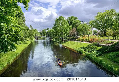 LATVIA, RIGA, JUNE, 20, 2015 - Kayak canoeing along the Riga river channel  in Riga central city park, capital of Latvia